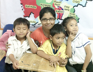 Volunteer with children at the orphanage project in Phnom Penh
