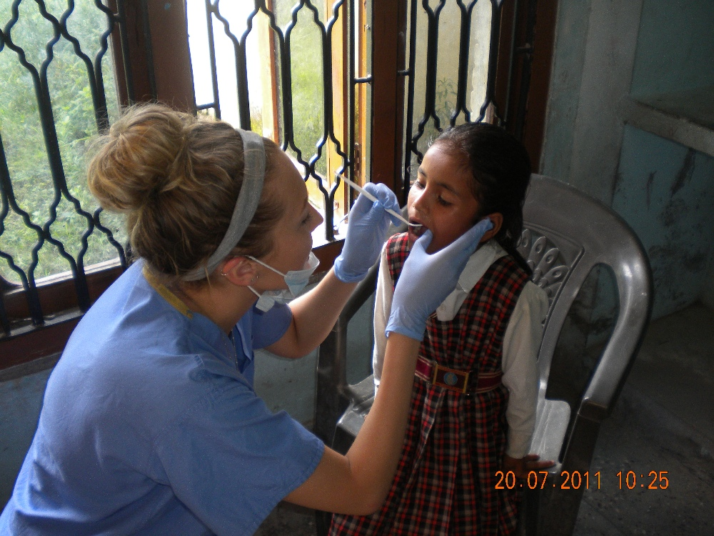 A dental elective intern examining a kid