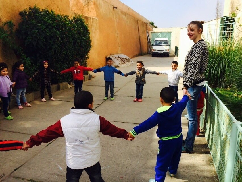 Volunteering solutions' volunteer playing with orphan kids in Morocco