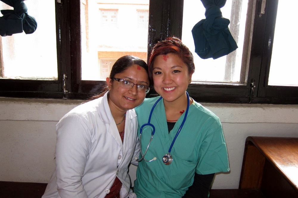Medical intern with doctor in Nepal