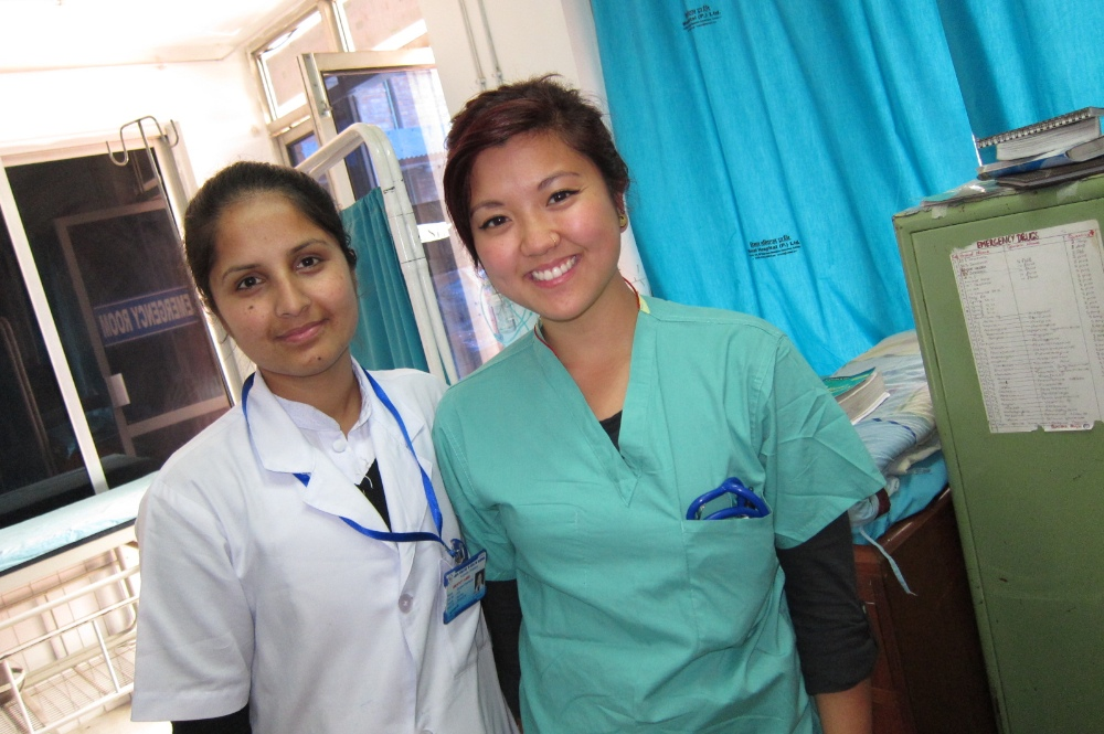 Medical volunteer with local staff in Nepal