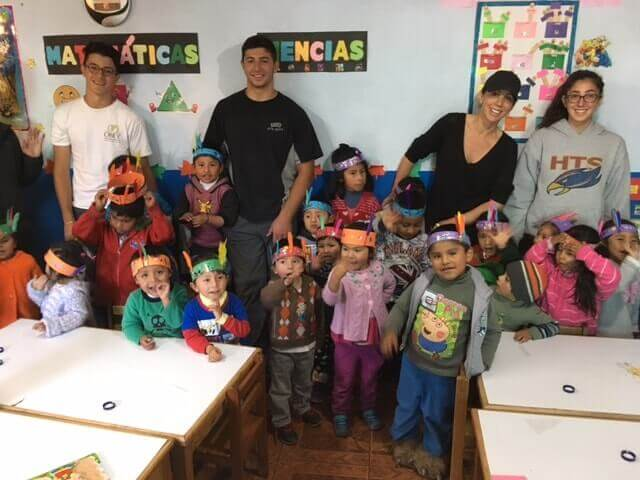 Family with kids at day care center in Peru>