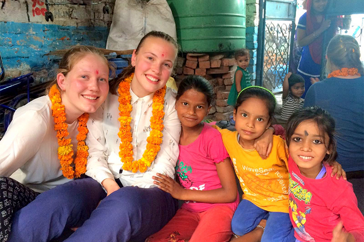 Students from a school group in Holland with children in Delhi, India>
