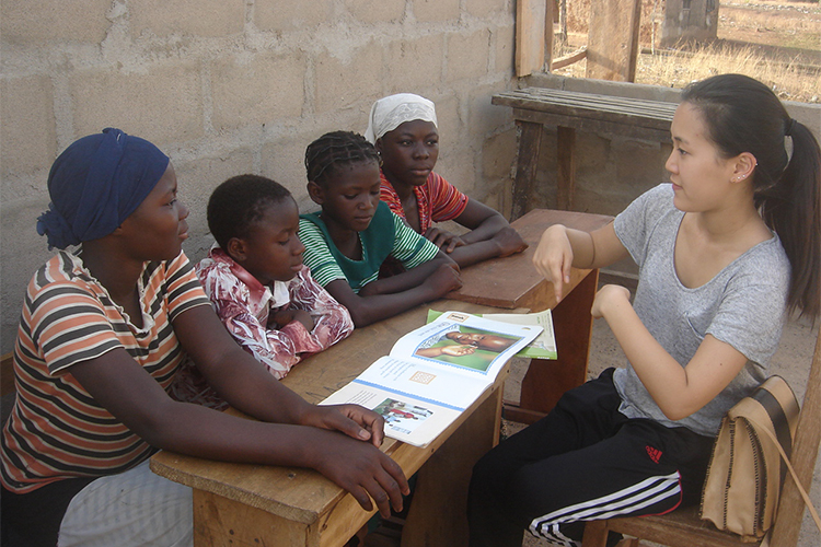 Student from High School Group interacting with students in Tamale, Ghana>