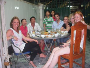 Volunteers with their host family in Cambodia