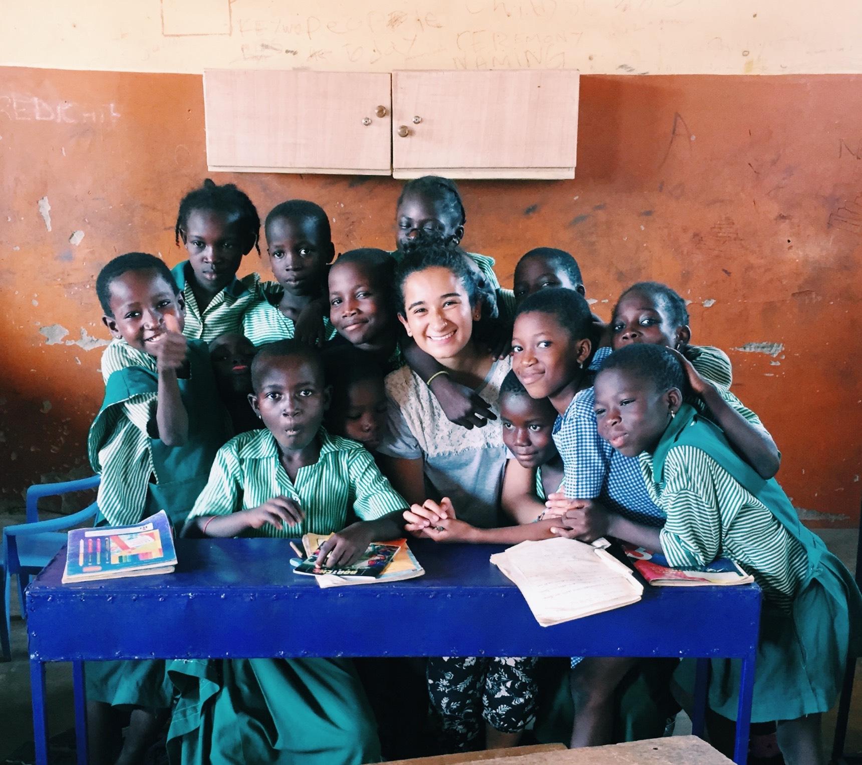 volunteer girl teaching in Ghana